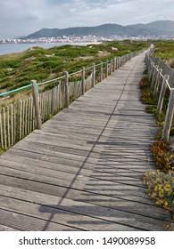 Pedestrian path in Sereia da Gelfa beach landscape.