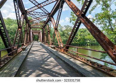 Pedestrian Rail Trail in the Catskills in Upstate NY crosses the Springtown Bridge over the Wallkill River  near New Paltz in the Hudson Valley, on a bright summer day.
