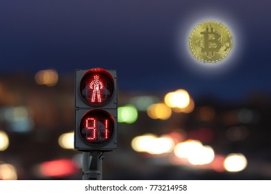 Pedestrian red traffic light at night with the timer on the background coin bitcoin instead of the moon shining brightly over a city at night. Don't accept bitcoin. To ban bitcoin.