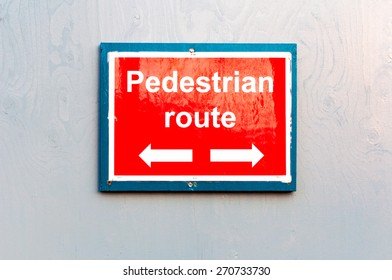 Pedestrian route direction notice board with reflection
