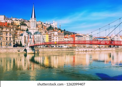 Pedestrian Saint Georges footbridge and the Saint Georges church in Lyon, France in a beautiful spring day