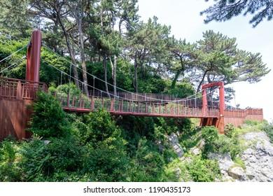 Pedestrian seaside Bridge on Dongbaek Island beside Haeundae beach in Busan, South Korea