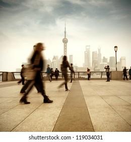 Pedestrian Shanghai Bund and Lujiazui skyscrapers