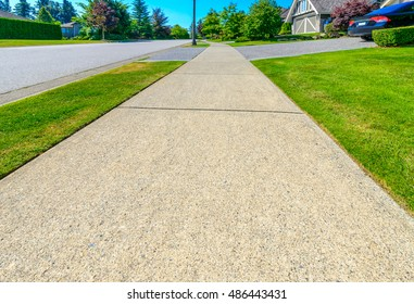 Pedestrian sidewalk in a nice neighborhood in the suburbs of Vancouver, Canada.