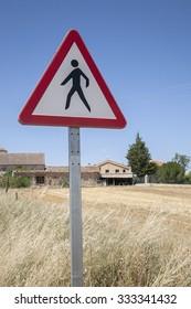 Pedestrian Sign against Blue Sky Background