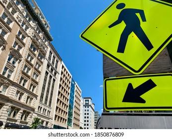 Pedestrian sign and arrow on city