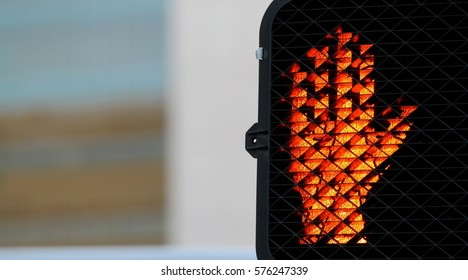 Pedestrian signal that shows you need to stop.