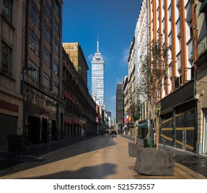 Pedestrian street in Downtown with Torre Latinoamericana on background - Mexico City, Mexico