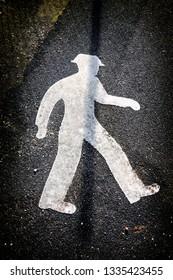 Pedestrian street sign on asphalt