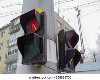 Pedestrian traffic lights with red stop signal.