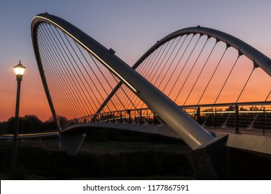 Pedestrian, Walking, Bicycling Bridge with Lights and Colorful, Beautiful Sunset.