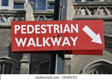 Pedestrian walkway arrow sign