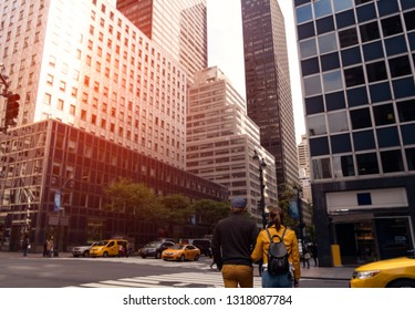 Pedestrians and car traffic on the street of lower Manhattan. New York. USA.