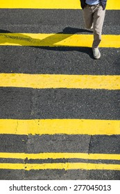 Pedestrians people moving at zebra crosswalk. Hong Kong. Crowded city abstract background