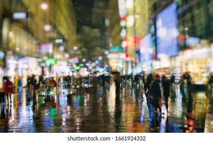 pedestrians walking on rainy night in the city vienna