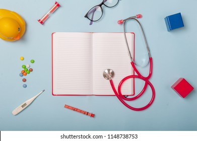 Pediatric doctor. Child health care. Doctor's office with book. stethoscope, thermometer, toys for kids, glasses. Family insurance.