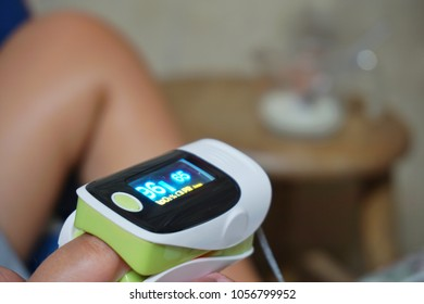 Pediatric patients are being measures the amount of oxygen in the blood and the rhythm of the heart with Pulse oximeter equipment.