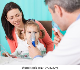Pediatrician checking baby patient. Doctor examining little baby girl.