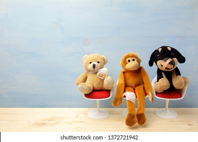 Pediatrician. Toy animals sitting on the chair in hospital. Health center for children.