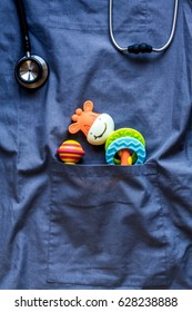 Pediatrics pocket with toys on blue background top view space for text