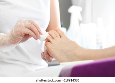Pedicure in the beauty salon. Foot and nail care treatment, woman at beautician on pedicure.