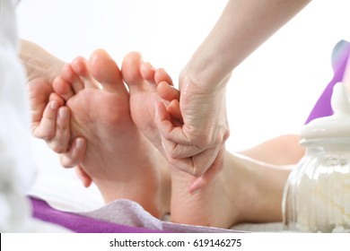 Pedicure and foot massage.Woman in a beauty salon for pedicure and foot massage.