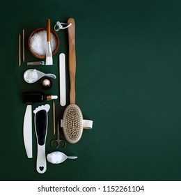 Pedicure Manicure Tools, Body Care Products, Massage Brush, Scrub Sea Salt on  Green Background. Square Frame.