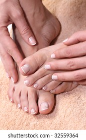 Pedicured feet and manicured hands