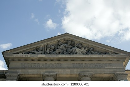 The pediment of the library of Mineralogy in Paris. Imitation of Doric style of ancient Greek architecture, grand entrance