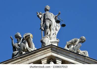 The pediment of theJustizpalast (Law Courts) building housing the district court of Munich and the Bavarian Justice Ministry with the figure of Justice flanked by Innocence and Vice.