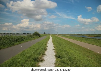 Pedistrian and cycle lane at dyke of river Rotte in Zevenhuizen