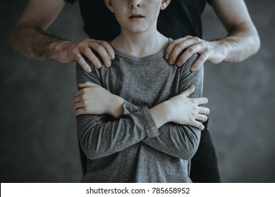 Pedophile and young boy as a victim of abuse