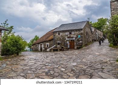PEDRAFITA DEL CEBRERO, SPAIN - JUN 13, 2017: Picturesque street with traditional stone houses