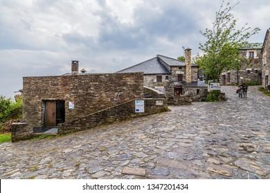 PEDRAFITA DEL CEBRERO, SPAIN - JUN 13, 2017: Street with stone houses