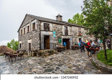 PEDRAFITA DEL CEBRERO, SPAIN - JUN 13, 2017: Tourists and pilgrims on the street of the town