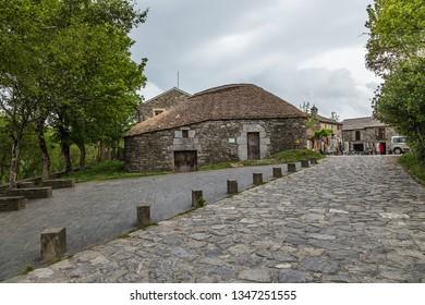 PEDRAFITA DEL CEBRERO, SPAIN - JUN 13, 2017: Traditional Celtic house with a reed roof pallozo