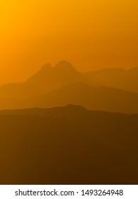 Pedraforca mountain with orange haze