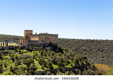 Pedraza, Castilla Y Leon, Spain: view of Pedraza Castle perched on a cliff from Mirador the Tungueras. Pedraza is one of the best preserved medieval villages of Spain