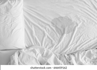 Pee on a bed mattress,Bedwetting sleep enuresis in Adults or baby concept ,selected focus at wet on the bed sheet