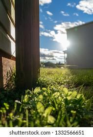 Peeking through the fence toward the sun at beautiful blue sky social media