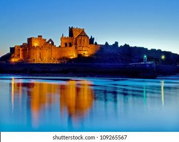 Peel Castle floodlit on the west coast of the Isle of Man