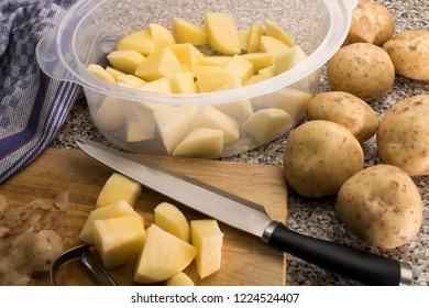 peel and cut some raw organic potato to steam the potatoes