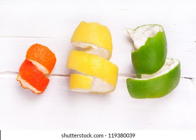 peel of lemon, tangerines and pomelo side by side, clementine, lemon, pomelo, orange, yellow, green