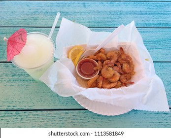 Peel N' Eat Boiled shrimp with cajun seasoning and a nice cold frozen lemonade to drink