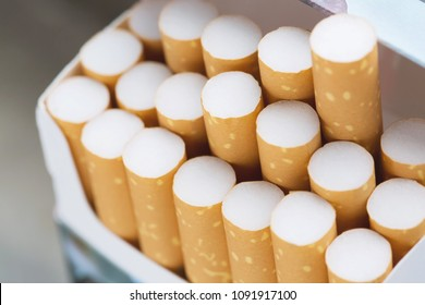 peel it off Cigarette pack prepare smoking a cigarette. Packing line up.  photo filters Natural light.