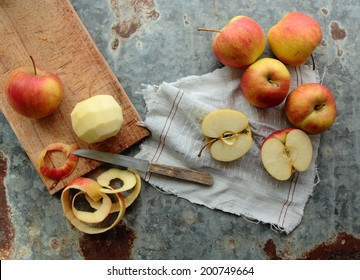 Peel and sliced apples on a kitchen board