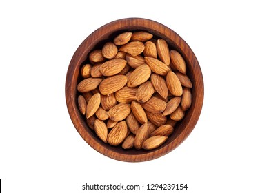Peeled  almond  in a wooden cedar plate on a white isolated background. Row of bowls with almond  nuts, top view. Peeled  almond pattern
