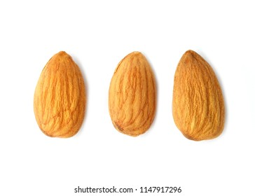 Peeled almonds isolated on white background.