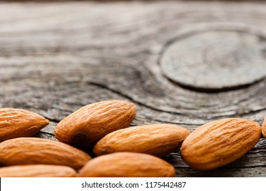 peeled almonds on old wood table