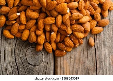 peeled almonds on old wood table